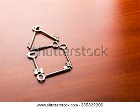 Keys in the shape of a house - stock photo
