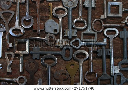Keys locks wooden background - stock photo