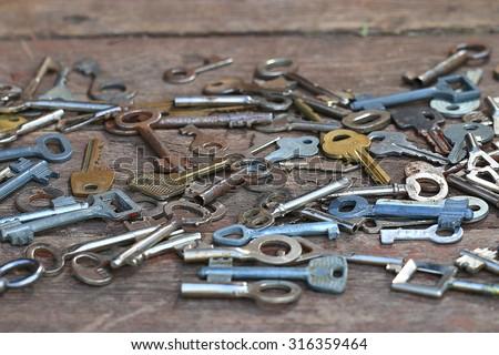 Keys locks wooden background - stock photo