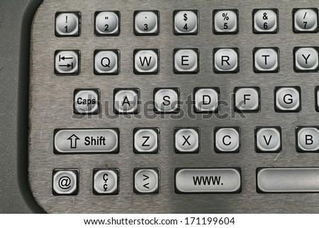 keys of a metal keyboard,.shallow depth of field - stock photo