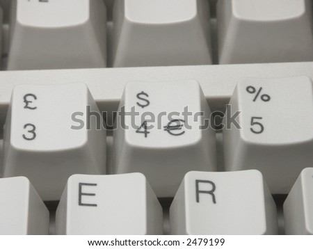 Keys of computer keyboard with dollar Euro and pound symbols - horizontal composition - stock photo