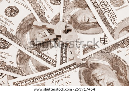 Keys on dollars background - stock photo