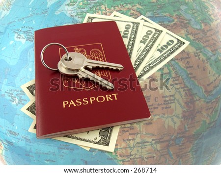 keys on passport, map in the background - stock photo