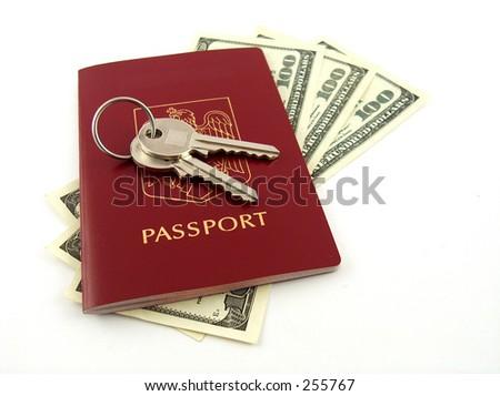 keys, passport and dollars - stock photo