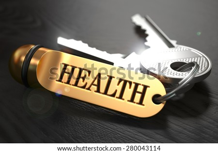 Keys to Health - Concept on Golden Keychain over Black Wooden Background. Closeup View, Selective Focus, 3D Render. - stock photo