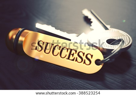 Keys to Success - Concept on Golden Keychain over Black Wooden Background. Closeup View, Selective Focus, 3D Render. Toned Image. - stock photo