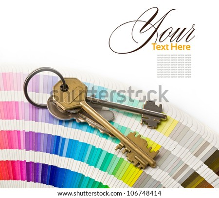keys to the apartment on theopen Pantone sample colors catalogue background - stock photo