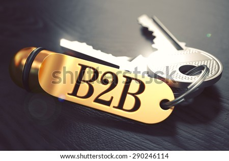 Keys with Word B2B - Business to Business - on Golden Label over Black Wooden Background. Closeup View, Selective Focus, 3D Render. Toned Image.