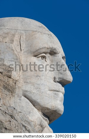 KEYSTONE, SOUTH DAKOTA - OCTOBER 31: George Washington profile at Mount Rushmore National Memorial on October 31, 2015 near Keystone, South Dakota - stock photo