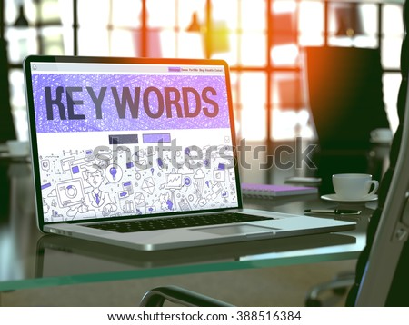 Keywords - Closeup Landing Page in Doodle Design Style on Laptop Screen. On Background of Comfortable Working Place in Modern Office. Toned, Blurred Image. 3D Render. - stock photo