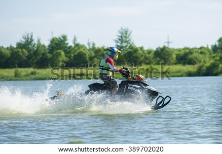 Khabarovsk, Russia - July 28, 2015: A man on snowmobile goes fast on the water in summer