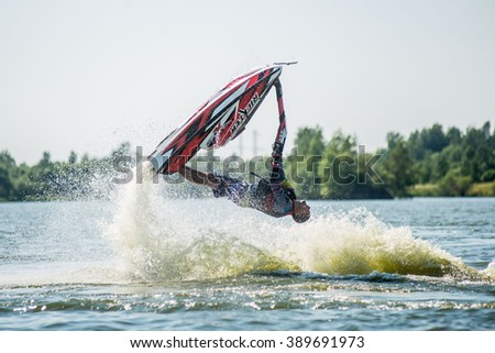 Khabarovsk, Russia - July 28, 2015: Man on jet ski turns with much splashes