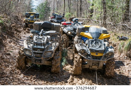 "Khabarovsk , Russia - may 10, 2015 : ATV rides through the mud with a big splash at ""Khabarovsk rally - 2015"""