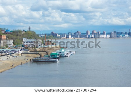 KHABAROVSK, RUSSIA - MAY 7, 2014: Embankment of the Amur River with new buildings and pleasure boats