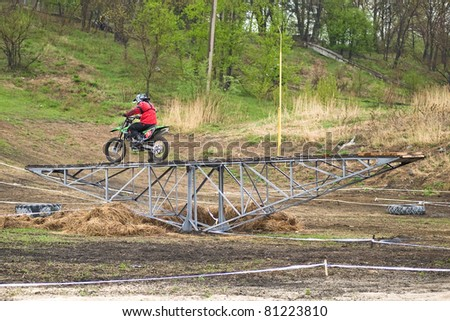 """KHABAROVSK RUSSIAN - MAY 21: Lykov Vecheslav in action at the first stage of the Khabarovsk enduro """"KHABARIGENS 2011 May 21, 2011 in Khabarovsk, Russia - stock photo"""