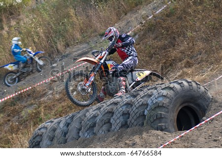 """KHABAROVSK RUSSIAN- SEPTEMBER 26: -Bibikov Oleg in action at  The second stage of the Khabarovsk enduro """"KHABARIGENS 2010 on September 26, 2010 in Khabarovsk Russia - stock photo"""