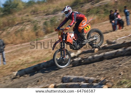 """KHABAROVSK RUSSIAN- SEPTEMBER 26: -Lykov Vecheslav in action at  The second stage of the Khabarovsk enduro """"KHABARIGENS 2010 on September 26, 2010 in Khabarovsk Russia - stock photo"""