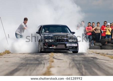 """KHABAROVSK RUSSIAN - SEPTEMBER 10: Melyoshin Roman in action at Round 5 competition """"DRAG RACING in Khabarovsk"""".  on September 10, 2010 in Khabarovsk Russia - stock photo"""