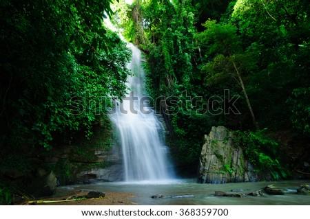 KHAGRACHARI, BANGLADESH- SEPTEMBER 06, 2012: This beautiful Waterfall commonly known as SHUKNACHARA FALLS amidst mesmerizing greenery is located in KHAGRACHARI, BANGLADESH. - stock photo