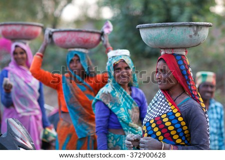 KHAJURAHO, INDIA - JANUARY 5, 2016: Indian women working hard in road-building in Khajuraho, Madhya Pradesh State, India