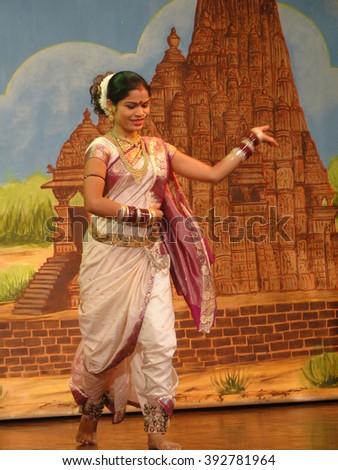 KHAJURAHO, INDIA - NOV 4, 2009 - Indian dancer performs classical dance in Khajuraho, India. - stock photo