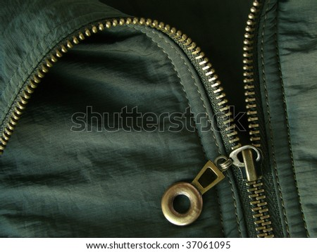 khaki jacket fragment with metal zipper - stock photo