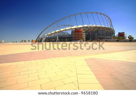 Khalifa (Kalifa) sports stadium in Doha, Qatar where the 2006 Asian games were hosted and location for the proposed 2016 Olympic Games (wide angle lens distortion on edges) HDR type image - stock photo
