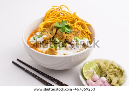 khao soi, beef curry noodles, northern thai food with side dish