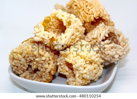Khao Tan, Nang Led, Rice Cracker is Thai snack and dessert with sugar cane syrup
