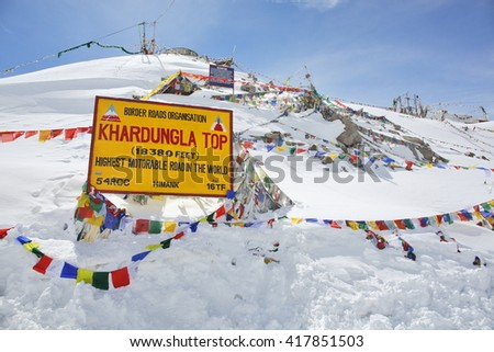 KHARDUNG LA PASS, INDIA - APRIL 21, 2016: mountain pass in the Ladakh region of Jammu and Kashmir state. The elevation of Khardung La is 5,360 m. Allegedly highest motorable troad in the world.