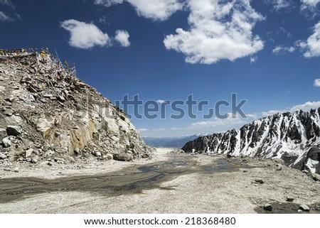 Khardung La pass road the highest motorable mountain pass ever - stock photo