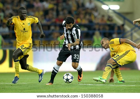 KHARKIV,UKRAINE-AUG 07:Athanasiadis (R) of PAOK in action with Gueye (L) of METALIST during the UEFA Champions League match METALIST vs PAOK at Metalist Arena on August 07,2013 in Kharkiv,Ukraine. - stock photo