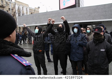 Kharkiv, Ukraine - Feb 14, 2016: Anarcho-feminist march during Valentine's Day, and its radical nationalist opponents.