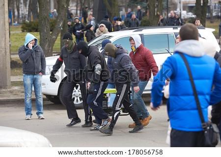 KHARKIV, UKRAINE - FEB 22 Congress Party of Regions of Ukraine's and protest civilians in Kharkov, Sports Palace area - stock photo