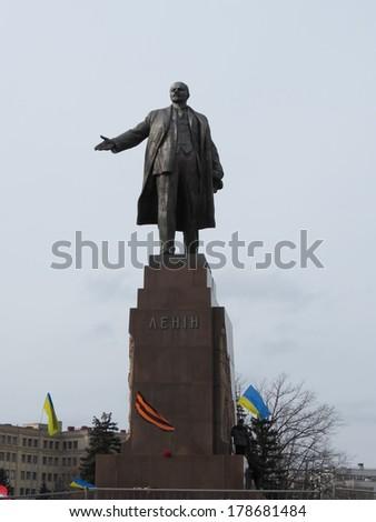 KHARKIV, UKRAINE - FEB 23,2014: The rally participants defend Lenin monument from demolition. - stock photo
