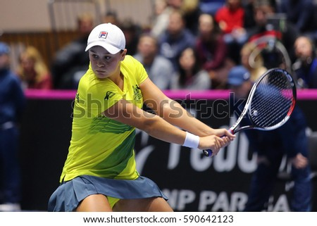 KHARKIV, UKRAINE - FEBRUARY 11, 2017: Ashleigh BARTY of Australia in action during BNP Paribas FedCup tennis game against Elina SVITOLINA of Ukraine at Palace of Sports Lokomotiv in Kharkiv, Ukraine