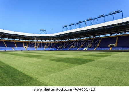 "KHARKIV, UKRAINE - JULY 29, 2014: Empty stadium ""Metalist"". Panoramic view from the pitch."