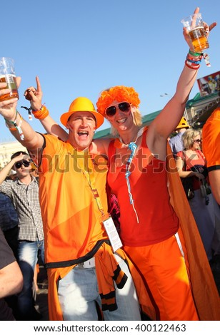 Kharkiv, Ukraine - June 17, 2012: Holland football fans having fun at the fanzone before Netherlands-Portugal match of UEFA EURO 2012