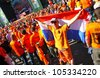 KHARKIV, UKRAINE - 13 JUNE: Holland football team supporters walk on a street of Kharkiv city before UEFA EURO 2012 game against Germany on 13 June, 2012 in Kharkiv, Ukraine - stock photo