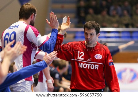 "KHARKIV, UKRAINE - MARCH 4, 2017: Goalkeeper KIREEV Victor gives five to BURKA Sergii. EHF Men's Champions League match HC Motor Zaporozhye vs Montpellier HB, Palace of Sports ""Lokomotiv"""