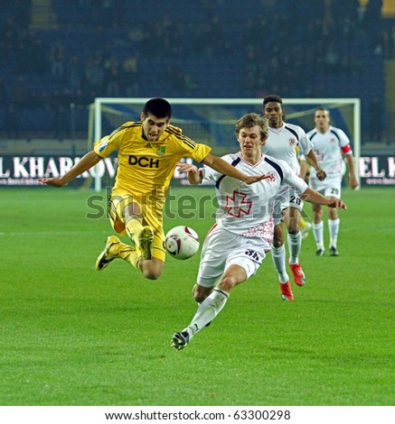 KHARKIV, UKRAINE - OCTOBER 16: FC Metalist Kharkiv DF Cristian Villagra (L) in action during football match vs. FC Volyn Lutsk (3:1), October 16, 2010 in Kharkov, Ukraine - stock photo