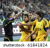 KHARKIV, UKRAINE - SEPTEMBER 25: FC Metalist Kharkiv players arguing with referee during football match vs. FC Shakhtar Donetsk, September 25, 2010 in Kharkov, Ukraine - stock photo