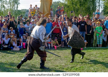 Kharkiv, Ukraine - September 10, 2016: Reconstruction of a medieval duel with swords during the ethnographic festival in Kharkiv region