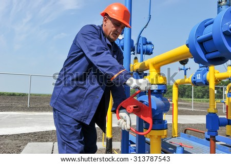 KHARKOV, UKRAINE - AUGUST 11, 2015: Employee working on the gas treatment plant into operation at the oil and gas condensate deposit