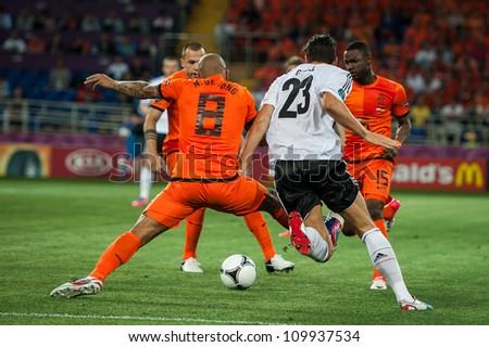 KHARKOV, UKRAINE - JUNE 08: Netherlands vs Denmark in action during football match in European soccer league (0:1), June 08, 2012 in Kharkov, Ukraine - stock photo