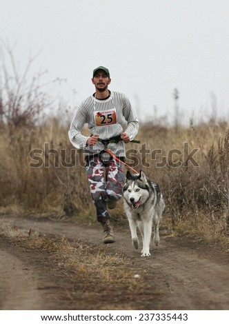 Kharkov, UKRAINE -?? November 15, 2014: Roman Golovko at canicross heats during Men's 3100 m at Sled dogs dry land race Autumn Cup - 2014