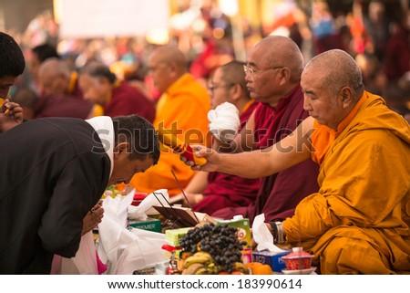 KHATMANDU, NEPAL - DEC 17, 2013: Unidentified tibetan Buddhist monks near stupa Boudhanath during festive Puja of H.H. Drubwang Padma Norbu Rinpoche's reincarnation's. - stock photo