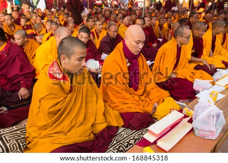 KHATMANDU, NEPAL - DEC 15: Unidentified tibetan Buddhist monks near stupa Boudhanath during festive Puja of H.H. Drubwang Padma Norbu Rinpoche's reincarnation's, Dec 15, 2013 in Khatmandu, Nepal. - stock photo