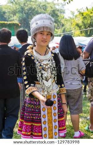 KHEK NOI, PHETCHABUN, THAILAND - DECEMBER 16: Unidentified traditionally dressed Hmong hill tribe girl play a ball in Hmong new year festival on December 16, 2012 in Phetchabun, Thailand. - stock photo