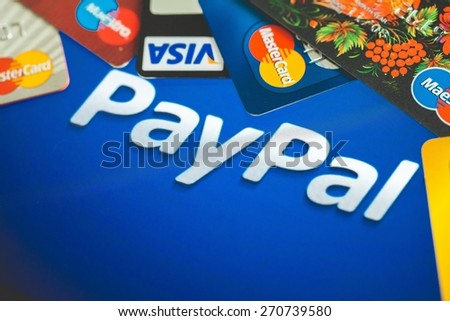 KHERSON, UKRAINE - FEBRUARY 05, 2015: App. Online shopping paid via Paypal payments using plastic cards Visa and Mastercard. PayPal is a popular and international method of money transfer via the - stock photo
